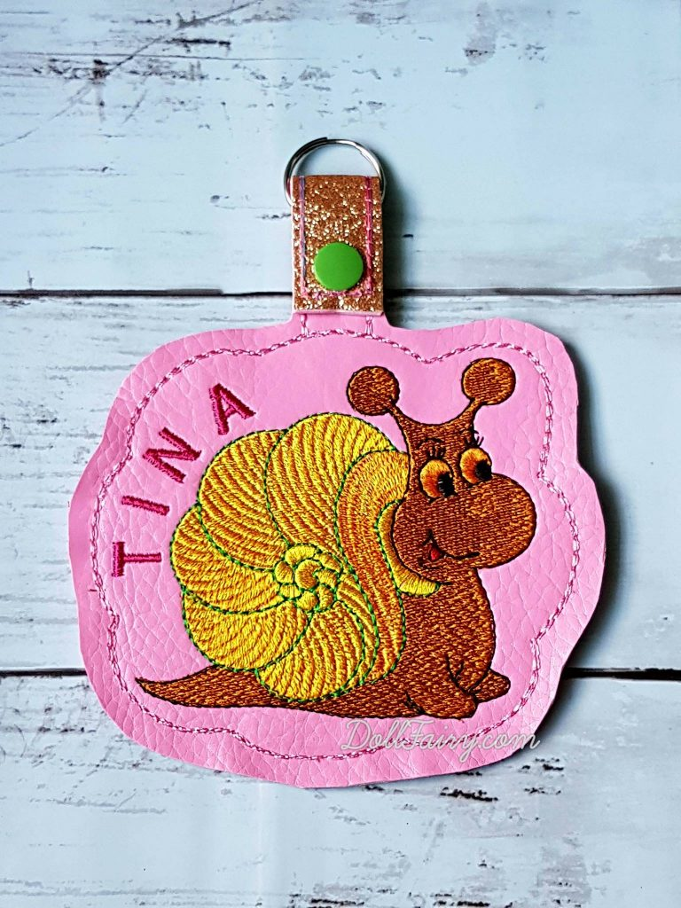 Snail Keychain with Personalised Name For Tina (Key Fob Snap Tab)