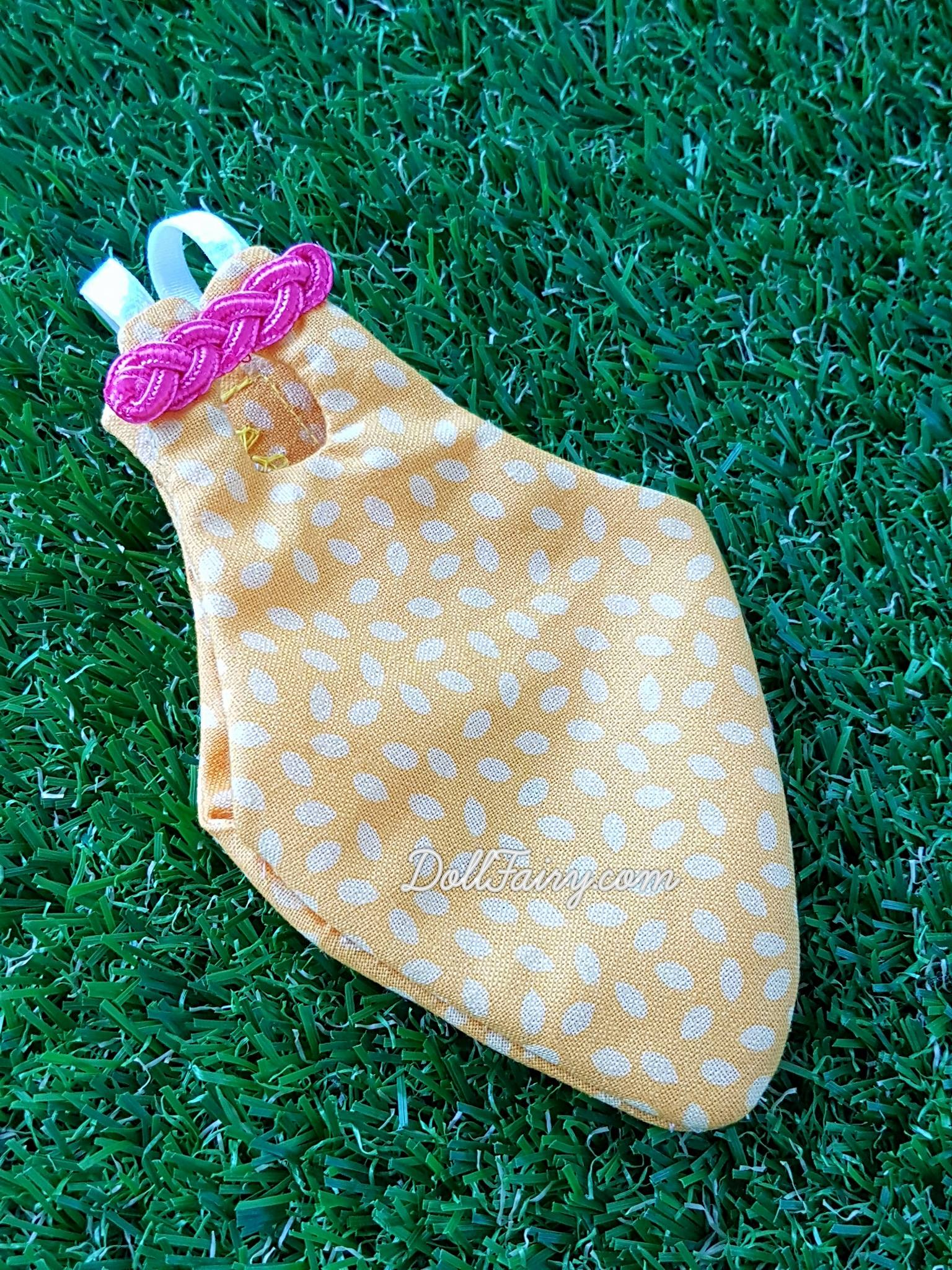 A yellow Cheongsam flight suit with pink oriental knot for a baby Caique parrot, Zaza!
