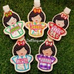 Group shot of the beautiful Kimono Kokeshi Japanese dolls key fob.