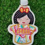 Gold Kimono Kokeshi Japanese doll key fob.