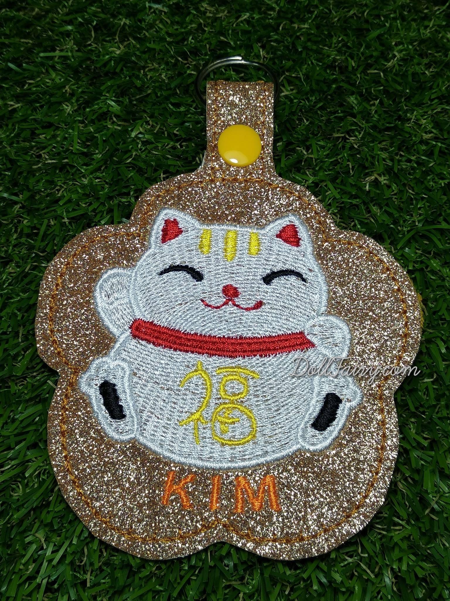 "Kim has a ""kimkim"" fortune cat!"