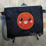 A smiley basketball on a black glitter pouch.